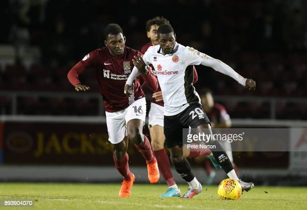 Amadou Bakayoko of Walsall controls the ball under pressure from Aaron Pierre of Northampton Town during the Sky Bet League One match between...