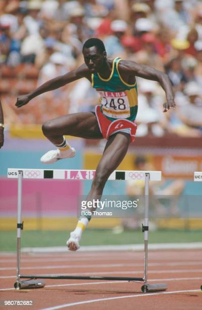 Amadou Dia Ba of Senegal competes in heat 5 of round one of the Men's 400 metres hurdles event inside the Memorial Coliseum at the 1984 Summer...