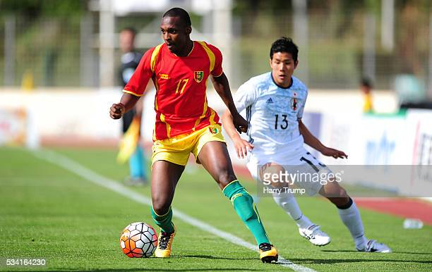 Amadou Diallo of Guinea is tackled by Hiromu Mitsumaru of Japan during the Toulon Tournament match between Guinea and Japan at Stade Antoinr Baptiste...