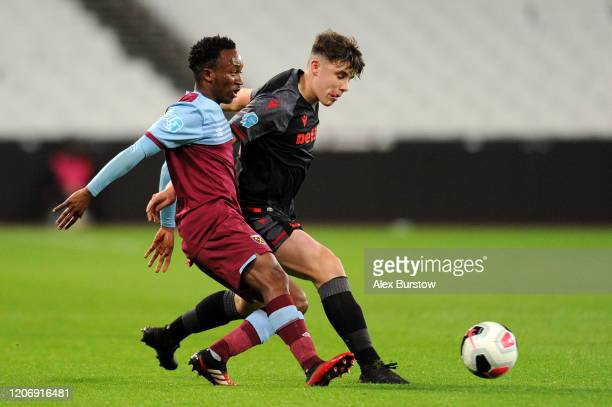 Amadou Diallo of West Ham United is tackled by Thomas Sparrow of Stoke City during the Premier League 2 match between West Ham United U23 and Stoke...