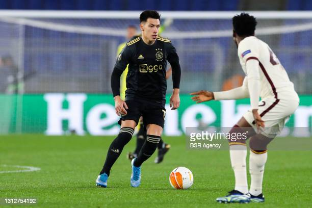 Amadou Diawara of AS Roma and Lisandro Martinez of Ajax during the UEFA Europa League Quarter Final: Leg Two match between AS Roma and Ajax at Stadio...