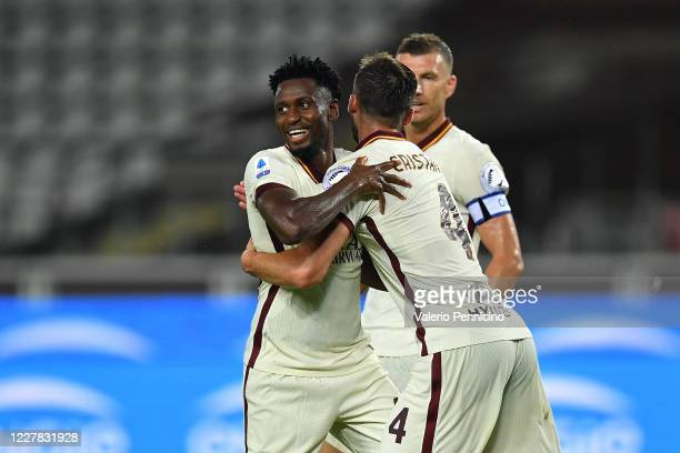 Amadou Diawara of AS Roma celebrates his goal from the penalty spot with team mate Bryan Cristante during the Serie A match between Torino FC and AS...
