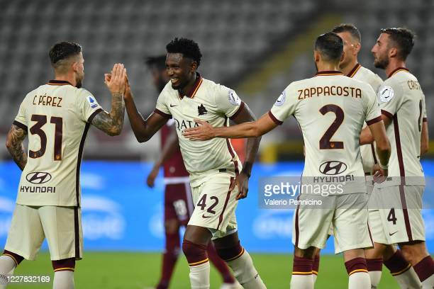 Amadou Diawara of AS Roma celebrates his goal from the penalty spot with team mate Carles Perez during the Serie A match between Torino FC and AS...
