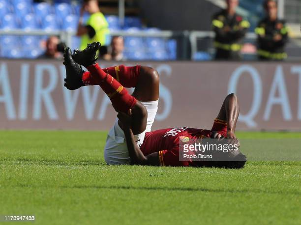 Amadou Diawara of AS Roma is injured during the Serie A match between AS Roma and Cagliari Calcio at Stadio Olimpico on October 6, 2019 in Rome,...