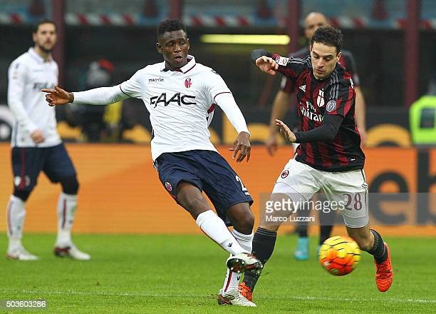 Amadou Diawara of Bologna FC is challenged by Giacomo Bonaventura of AC Milan during the Serie A match between AC Milan and Bologna FC at Stadio...