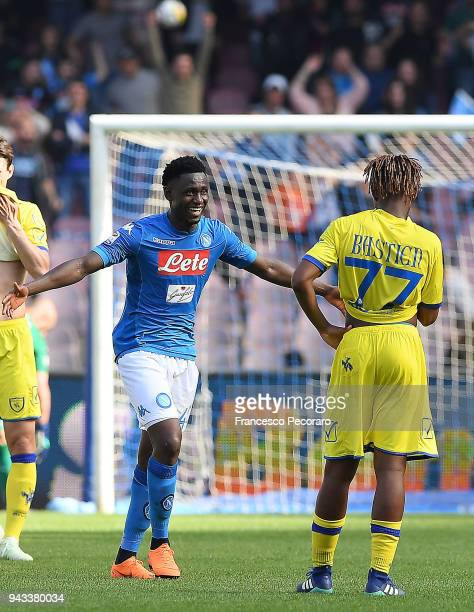 Amadou Diawara of SSC Napoli celebrates the victory beside the disappointment of AC Chievo Verona players after the serie A match between SSC Napoli...