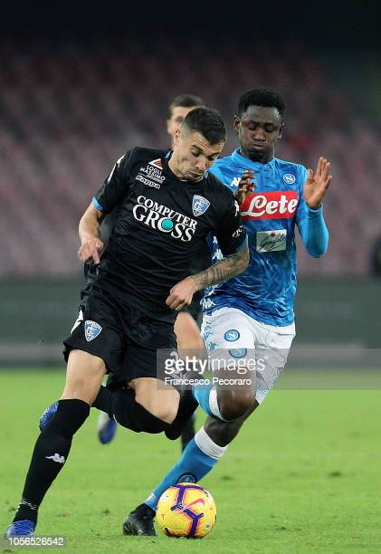 Amadou Diawara of SSC Napoli vies Rade Krunic of Empoli during the Serie A match between SSC Napoli and Empoli at Stadio San Paolo on November 2 2018...