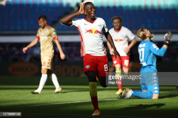 Amadou Haidara of Leipzig celebrates his team's third goal during the Bundesliga match between RB Leipzig and 1. FSV Mainz 05 at Red Bull Arena on...
