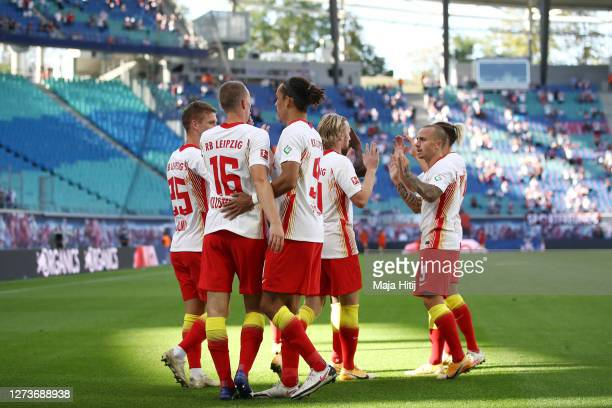 Amadou Haidara of Leipzig celebrates his team's third goal with teammates during the Bundesliga match between RB Leipzig and 1. FSV Mainz 05 at Red...