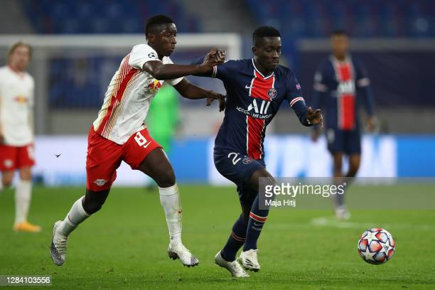 Amadou Haidara of RB Leipzig and Idrissa Gueye of Paris Saint-Germain battle for possession during the UEFA Champions League Group H stage match...