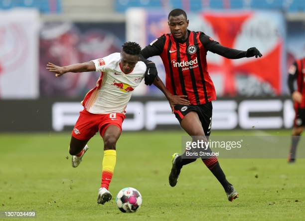 Amadou Haidara of RB Leipzig battles for possession with Evan Ndicka of Eintracht Frankfurt during the Bundesliga match between RB Leipzig and...