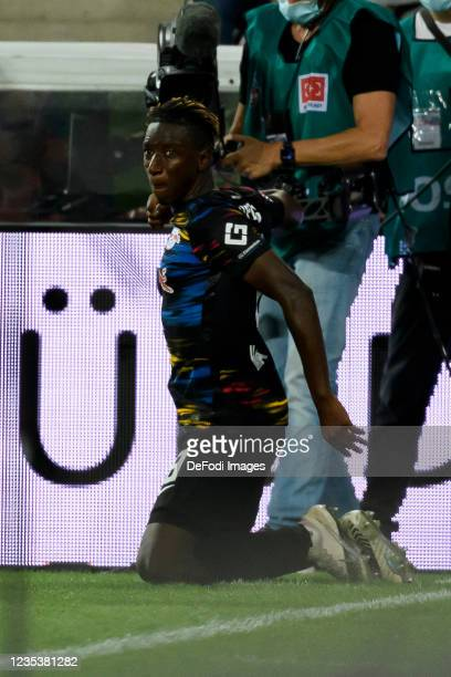 Amadou Haidara of RB Leipzig celebrates after scoring his team's first goal during the Bundesliga match between 1. FC Koeln and RB Leipzig at...