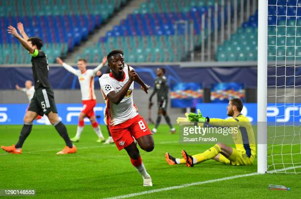 Amadou Haidara of RB Leipzig celebrates after scoring their team's second goal during the UEFA Champions League Group H stage match between RB...