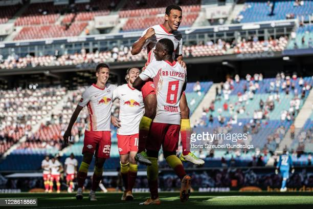 Amadou Haidara of RB Leipzig celebrates with teammates after scoring his team's third goal during the Bundesliga match between RB Leipzig and 1. FSV...