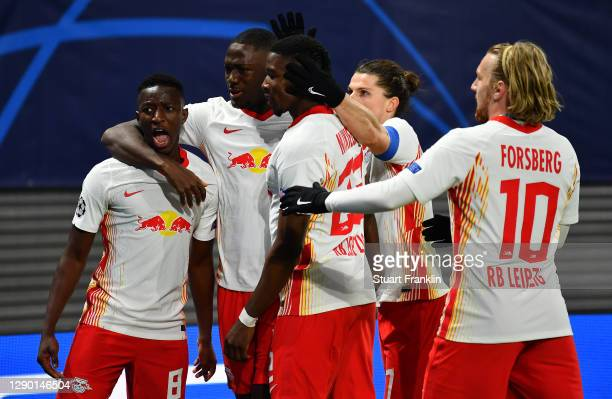 Amadou Haidara of RB Leipzig celebrates with teammates after scoring their sides second goal during the UEFA Champions League Group H stage match...