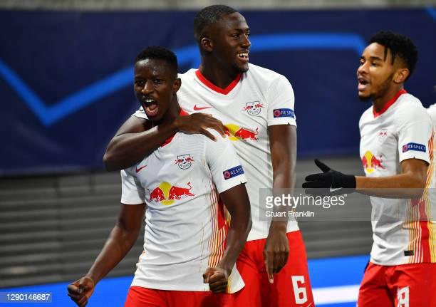 Amadou Haidara of RB Leipzig celebrates with teammates Ibrahima Konate and Christopher Nkunku after scoring their sides second goal during the UEFA...