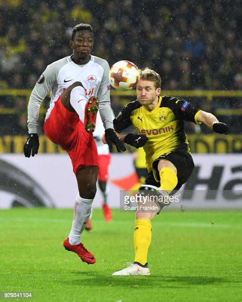 Amadou Haidara of Red Bull Salzburg and Andre Schuerrle of Borussia Dortmund battle for the ball during the UEFA Europa League Round of 16 match...