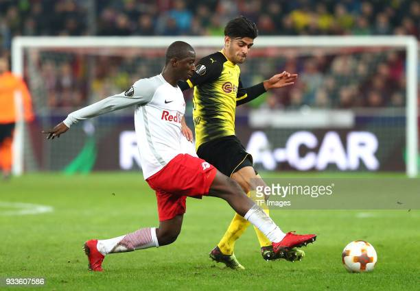 Amadou Haidara of Salzburg and Mahmoud Dahoud of Dortmund battle for the ball during UEFA Europa League Round of 16 second leg match between FC Red...
