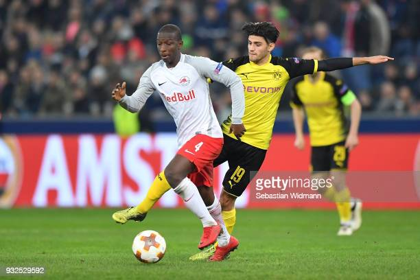 Amadou Haidara of Salzburg and Mahmoud Dahoud of Dortmund compete for the ball during the UEFA Europa League Round of 16 2nd leg match between FC Red...