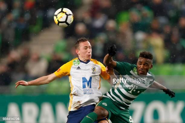 Amadou Moutari of Ferencvarosi TC battles for the ball in the air with Dejan Trajkovski of Puskas Akademia FC during the Hungarian OTP Bank Liga...