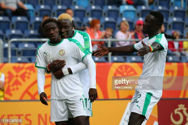Amadou Sagna of Senegal celebrates with Dion Lopy after scoring his second goal during the 2019 FIFA U20 World Cup group A match between Tahiti and...