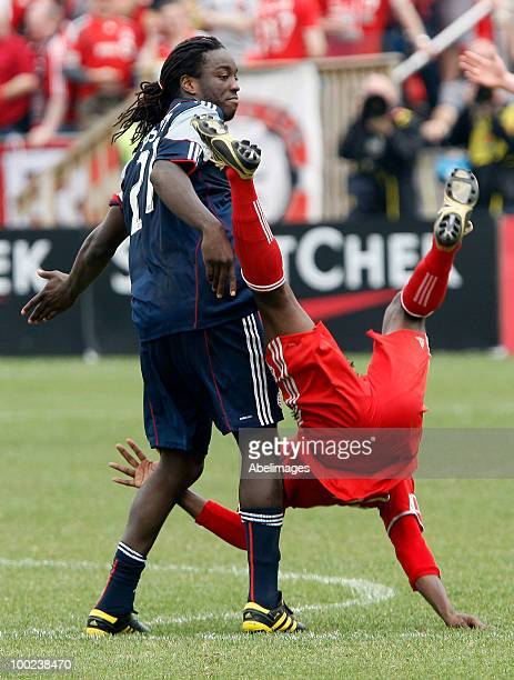 Amadou Sanyang of Toronto FC gets hit by Shalrie Joseph of the New England Revolution during a MLS game at BMO Field May 22 2010 in Toronto Ontario...