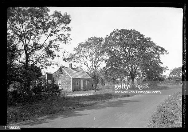 Amagansett / Wainscott, Long Island: small unidentified wood-shake house beside dirt road, New York, New York, late 19th or early 20th century.