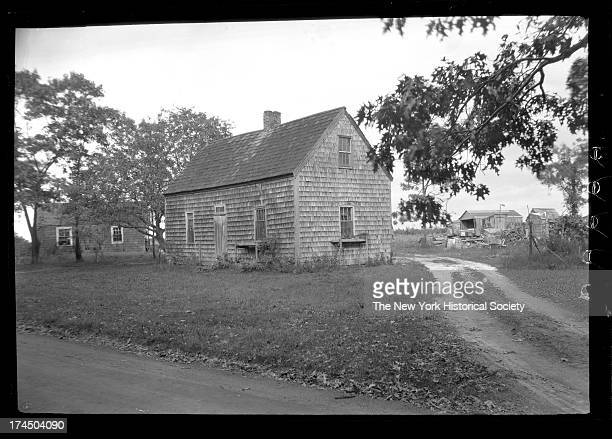 Amagansett / Wainscott, Long Island: unidentified small wood-shake house with various outbuildings, New York, New York, late 19th or early 20th...