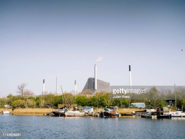 amager bakke waste plant in amager, copenhagen, denmark - oresund region stock photos and pictures
