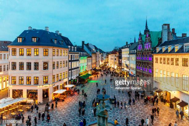 amagertorv square decorated with christmas lights, copenhagen, denmark - copenhagen stock pictures, royalty-free photos & images