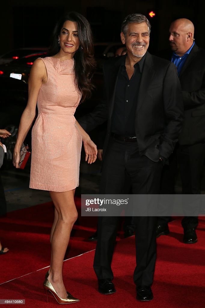 Amal Alamuddin (L) and actor George Clooney attend the premiere of Warner Bros. Pictures' 'Our Brand Is Crisis' at TCL Chinese Theatre on October 26, 2015 in Hollywood, California.