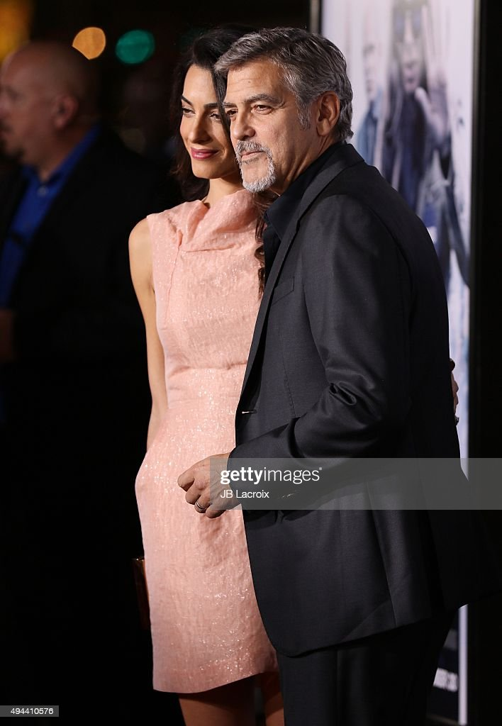 Amal Alamuddin and George Clooney attend the premiere of Warner Bros. Pictures' 'Our Brand Is Crisis' at TCL Chinese Theatre on October 26, 2015 in Hollywood, California.