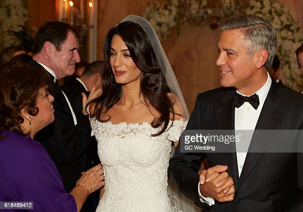Amal Alamuddin and George Clooney with mother of bride Baria Alamuddin and actor Richard Kind at the George Clooney and Amal Alamuddin Wedding on...