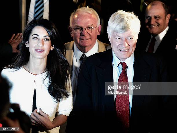 Amal Alamuddin Clooney with archaeologist David Hill and barrister Geoffrey Robertson arrive to a central hotel in Athens on October 13 2014 in...