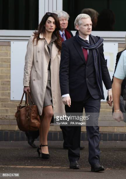 Amal Alamuddin walking alongside WikiLeaks founder Julian Assange as they leave Belmarsh Magistrates Court after his extradition hearing to Sweden to...