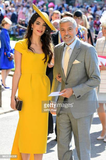 Amal and George Clooney arrive at St George's Chapel at Windsor Castle before the wedding of Prince Harry to Meghan Markle on May 19 2018 in Windsor...