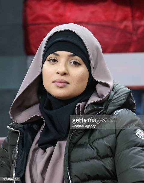 Amal Belhanda wife of Galatasaray's Younes Belhanda during the anthem singing ceremony prior to the Turkish Super Lig match between Galatasaray and...