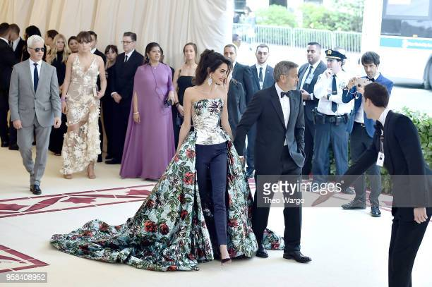 Amal Clooney and actor George Clooney attend the Heavenly Bodies Fashion The Catholic Imagination Costume Institute Gala at The Metropolitan Museum...