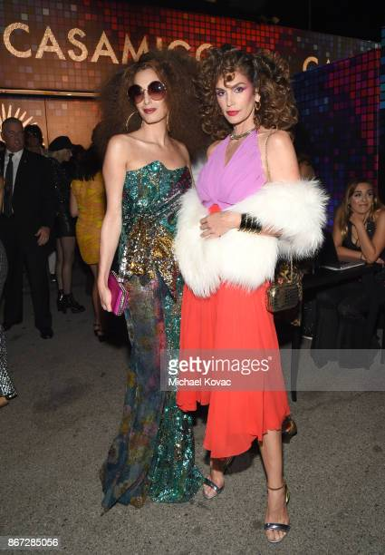 Amal Clooney and Cindy Crawford attend Casamigos Halloween Party on October 27 2017 in Los Angeles California