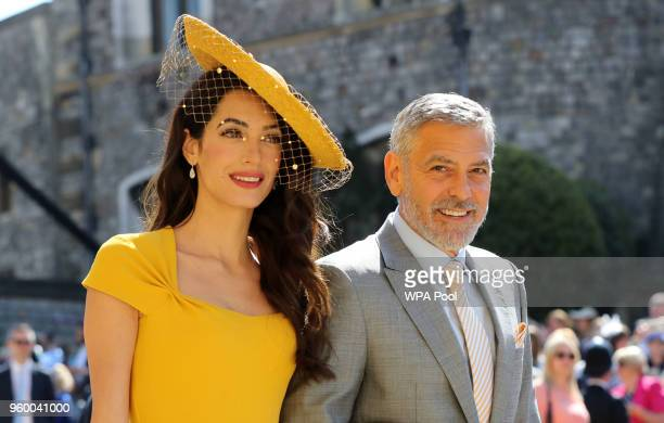 Amal Clooney and George Clooney arrive at St George's Chapel at Windsor Castle before the wedding of Prince Harry to Meghan Markle on May 19 2018 in...