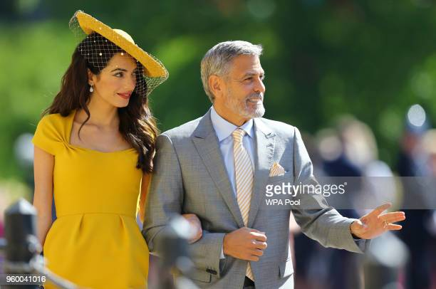 Amal Clooney and George Clooney arrive at St George's Chapel at Windsor Castle before the wedding of Prince Harry to Meghan Markle on May 19, 2018 in...