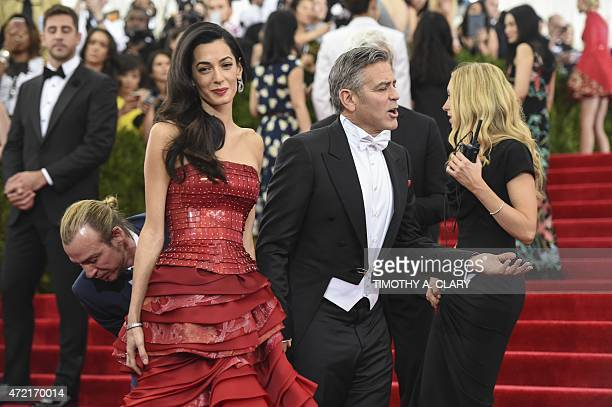 Amal Clooney and George Clooney arrive at the Costume Institute Gala Benefit at The Metropolitan Museum of Art May 5 2015 in New York AFP PHOTO /...