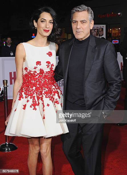 Amal Clooney and George Clooney arrive at the Los Angeles Premiere 'Hail Caesar' at Regency Village Theatre on February 1 2016 in Westwood California