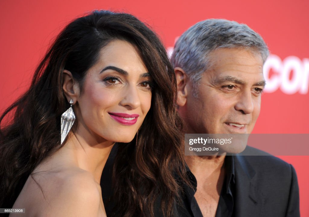 Amal Clooney and George Clooney arrive at the premiere of Paramount Pictures' 'Suburbicon' at Regency Village Theatre on October 22, 2017 in Westwood, California.