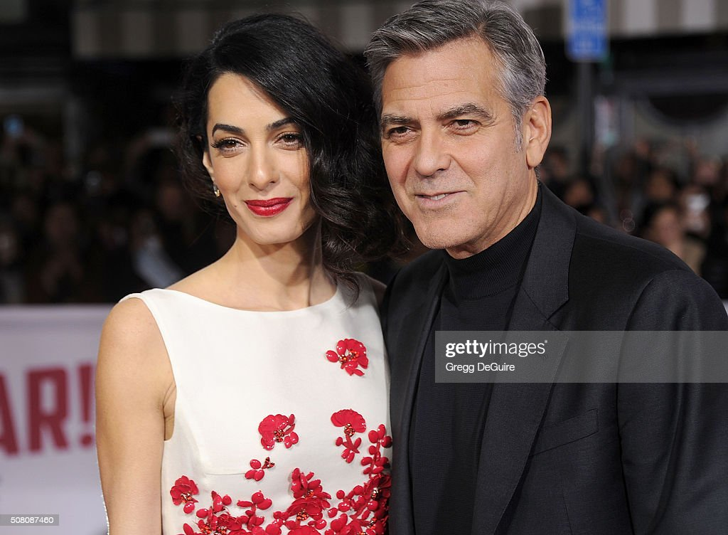 Amal Clooney and George Clooney arrive at the premiere of Universal Pictures' 'Hail, Caesar!' at Regency Village Theatre on February 1, 2016 in Westwood, California.