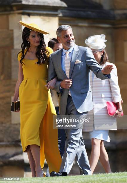 Amal Clooney and George Clooney arrive at the wedding of Prince Harry to Ms Meghan Markle at St George's Chapel Windsor Castle on May 19 2018 in...