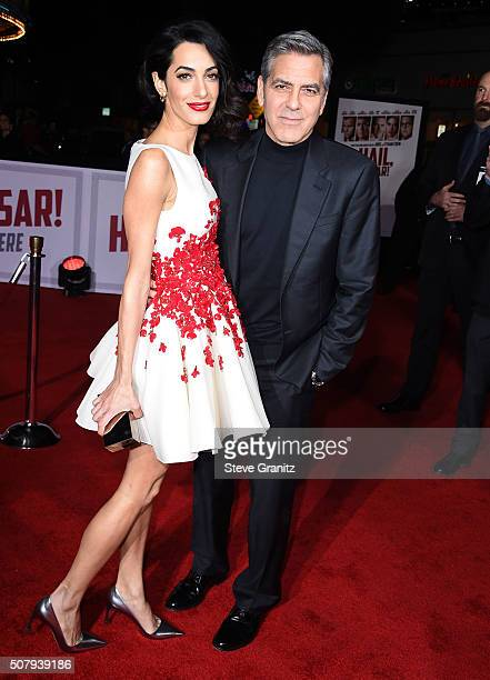 Amal Clooney and George Clooney arrives at the Premiere Of Universal Pictures' 'Hail Caesar' at Regency Village Theatre on February 1 2016 in...