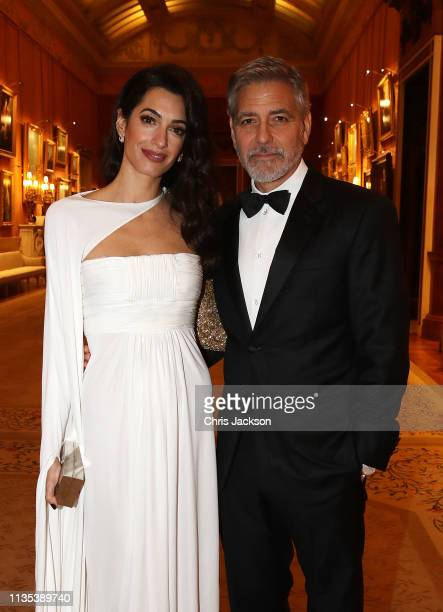 Amal Clooney and George Clooney attend a dinner to celebrate The Prince's Trust hosted by Prince Charles Prince of Wales at Buckingham Palace on...