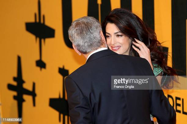 Amal Clooney and George Clooney attend 'Catch-22' Photocall, a Sky production, at The Space Moderno Cinema on May 13, 2019 in Rome, Italy.