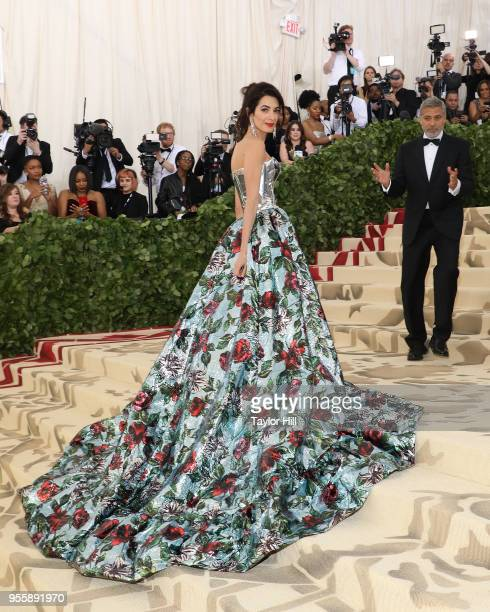 Amal Clooney and George Clooney attend 'Heavenly Bodies Fashion the Catholic Imagination' the 2018 Costume Institute Benefit at Metropolitan Museum...